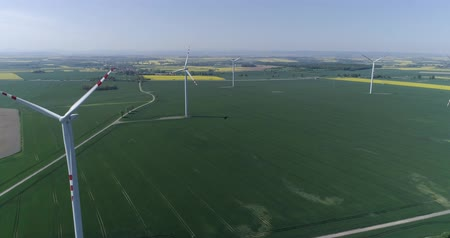 energetyka : green technology, aerial drone view on wind turbines and green field in slow motion Wideo