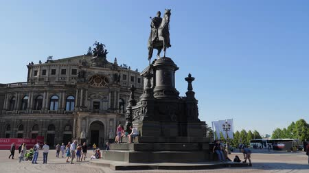 reneszánsz : Dresden, Germany 18 May 2018: Theaterplatz, tourists near statue of King John of Saxony on background of Semper Opera in Dresden, 18 May 2018.