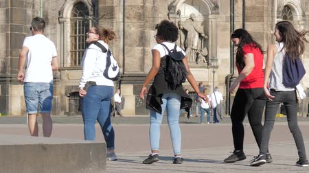 friendship dance : Dresden, Germany 18 May 2018: tourism, girls into casual clothes learn the dance on the street and having fun in slow motion in Dresden, 18 May 2018. Stock Footage