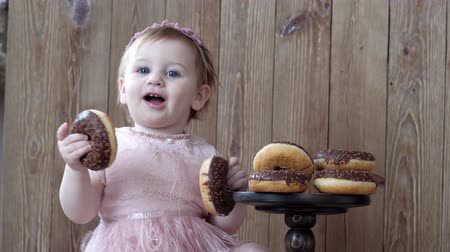 cruller : game with food, baby with chocolate cookies on background of wooden wall indoors