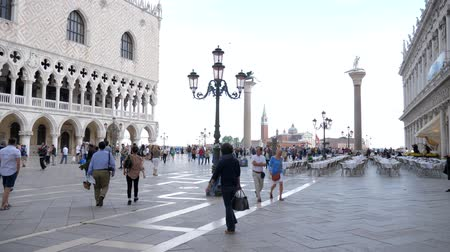 piazza : Venice, Italy 19 May 2018: European tour, lot people walk at St. Marks Square near Columns in Venice, 19 May 2018.