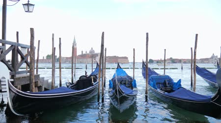 Венеция : Venice, Italy 19 May 2018: Gondola moored with view of San Giorgio Maggiore at grand canal in Venice, 19 May 2018. Стоковые видеозаписи