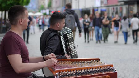 enstrümanlar : Wroclaw, Poland 12 May 2018: Street musicians play on xylophone and accordion for passersby at city in slow motion in Wroclaw, 12 May 2018. Stok Video