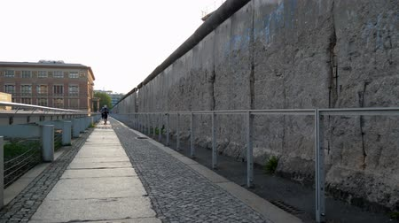 ayrılmış : Berlin, Germany 15 May 2018: historical sites of Europe, shooting along the Berlin Wall Memorial with holes in concrete in Berlin, 15 May 2018.