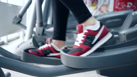 elliptical : people performs exercise on Elliptical trainers in sports Complex close-up Stock Footage