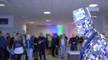 странный : Kherson, Ukraine 10 February 2018: creative show, man in mirror clothing entertains viewers at entertainment indoors in Kherson, 10 February 2018.
