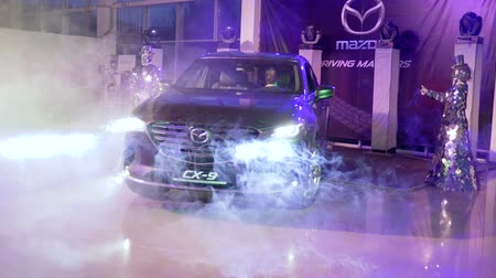 fog machine : Kherson, Ukraine 10 February 2018: showing automobile at sales center with fancy people in shiny suits in smoke in Kherson, 10 February 2018. Stock Footage