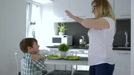 do interior : family dances, female teaches child to dance in bright room on vacation