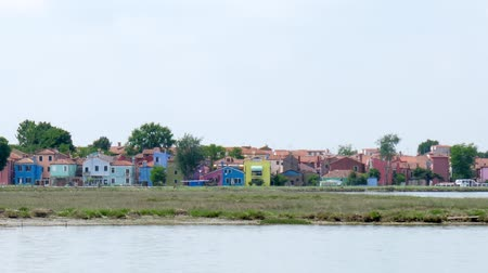 burano : Burano, Italy 19 May 2018: colorful houses and famous crooked bell tower from the side of the ship in Burano, 19 May 2018.