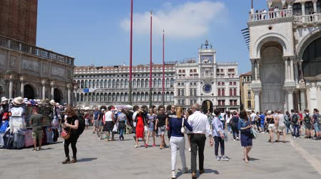 historical : Venice, Italy 19 May 2018: tourism, crowd of people are walking on Piazza San Marco on background of architectural buildings in Venice, 19 May 2018.