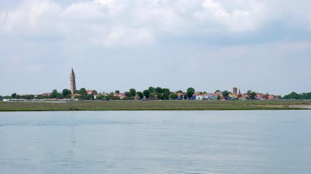 burano : Burano, Italy 19 May 2018: village on water, view of town houses from sea against sky in Burano, 19 May 2018. Stock Footage