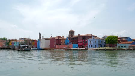 burano : Burano, Italy 19 May 2018: europe tourist town with colorful houses on sea coast on background heaven in Burano, 19 May 2018.