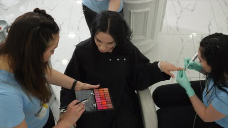 simultaneously : fast services, happy female doing manicure during make-up and hairstyles in beauty Studio
