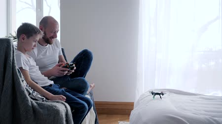 propeller toy : family entertainment, quadrocopter takes off from the dads hand and hovers over the bed