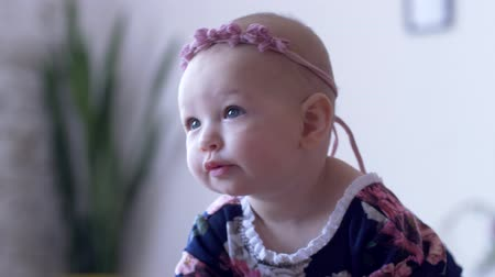korale : beautiful little girl with stylish decoration on head showing tongue close-up on unfocused background