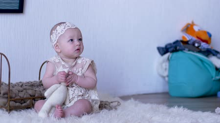 korale : baby toy, little girl in stylish suit with soft cat sitting on floor in bright studio