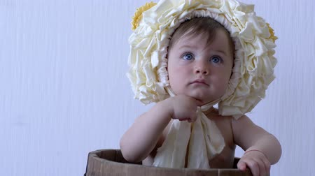 korale : little child with wreath on head laughs close-up on background white wall Wideo