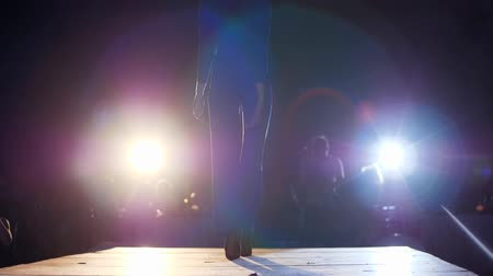 high heeled shoe : model girl into high heels into elegant suit goes on podium in lighting of spotlight in front of public at slow motion Stock Footage