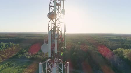 telephone tower : serves cellular antenna, technician worker repair telecommunication tower on sunlight at background Stock Footage