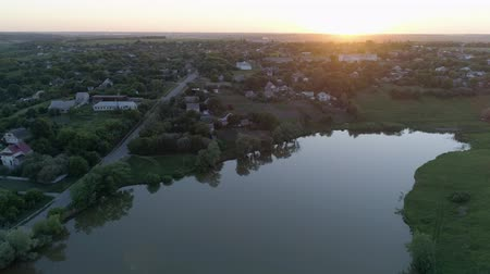 loch : Aerial view on small town near lake at sundown in spring