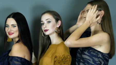 týden : collection demonstration, merry beautiful models during photo shoot posing in luxurious clothes with cool makeup