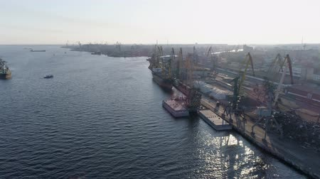 újrahasznosítható : shipping, aerial view of industrial cargo port with cranes and ships in backlight