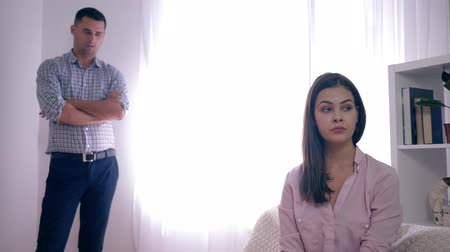desfocado : married couples in crisis, despair and anger of woman after an argument with husband on unfocused background in bright room at home