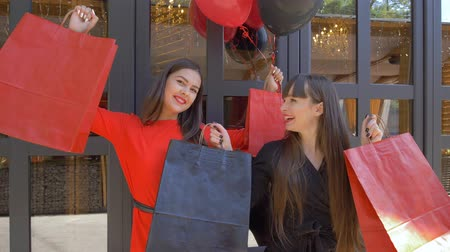 rejoices : shopping holiday, funny women enjoy new purchases from store in season of discounts at black friday