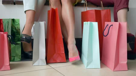 new clothes : shopping holiday, foot of women with lots vivid purchases bags Close-ups in season of discounts and sales