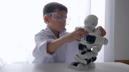 functionality : modern little boy mounting automated robot with Artificial Intelligence indoors