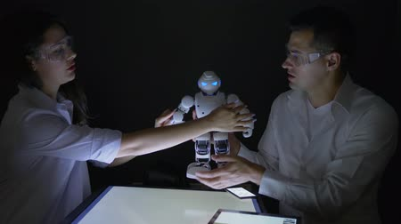 functionality : Electronics engineers check functionality of modern robot with artificial intelligence in dark laboratory