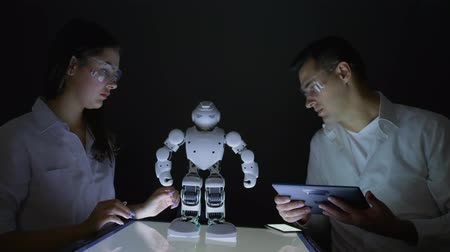 functionality : engineers People researching artificial intelligence modern robot with artificial intelligence in dark lab