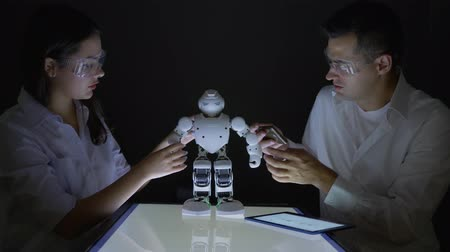 functionality : innovation robotic technology, scientists engineers check functionality of smart robot in modern dark laboratory