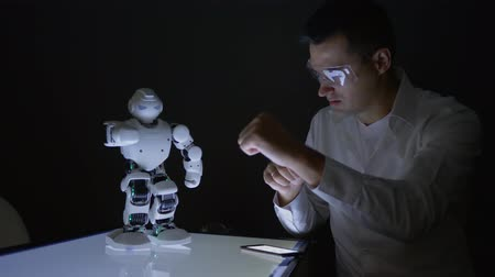 functionality : innovative future, engineers scientists male studying abilities artificial intelligence of modern robot in dark lab