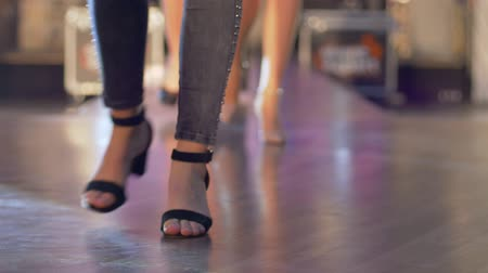 semana de moda : female models walk the runway during the fashion week show, legs and shoes only in slow motion