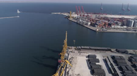 moorage : sea port panorama with containers and lifting cranes for loading and unloading of ships on Sea waterfront, drone view