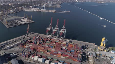 moorage : ODESSA, UKRAINE - OCTOBER 17, 2018: drone view of trading port industry with containers and lifting cranes for loading and unloading of vessel on Black Sea quayside