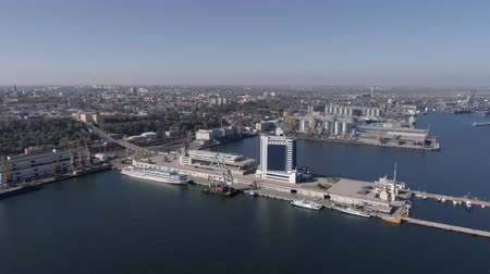 moorage : ODESSA, UKRAINE - OCTOBER 17, 2018: panorama of city seaside international port with hotel and ships on Black Sea Embankment against blue sky, aerial view Stock Footage