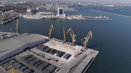 moorage : ODESSA, UKRAINE - OCTOBER 17, 2018: port industry during building with Construction Materials and lifting cranes on Black Sea quay, Top view