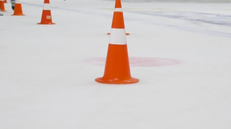 top sürme : KHERSON, UKRAINE - OCTOBER 17, 2018: Hockey player with stick moves puck and rides around cones on ice field close up