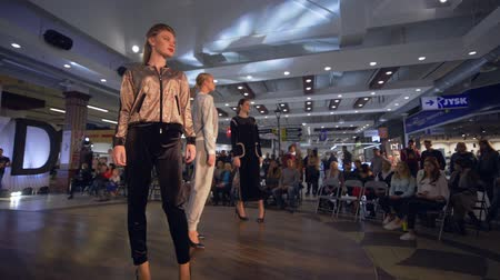 high heeled shoe : KHERSON, UKRAINE - OCTOBER 20, 2018: fashion event, models girls in high heels go on podium on Defile show of new collection clothes at fashion Week
