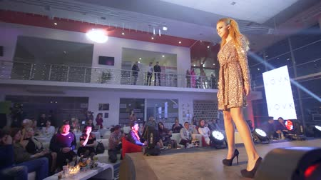 high heeled shoe : KHERSON, UKRAINE - DECEMBER 01, 2018: model podium into brilliant cocktail dress in high heels presents designer collection at fashion show into floodlight