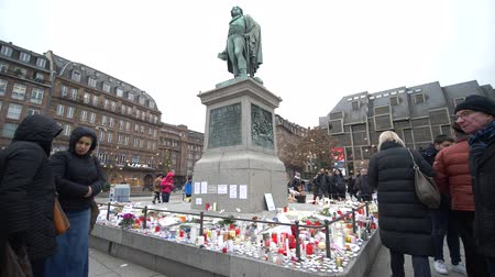 aftermath : STRASBOURG, FRANCE - DECEMBER 18, 2018: flowers and candles at statue of General Kleber, vigil place after Christmas Market terrorist attacks Stock Footage