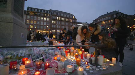 elesett : STRASBOURG, FRANCE - DECEMBER 18, 2018: place of death of people from terrorist attack, grieving have brought Flowers and light candles in memory of victims Terrorism on eve Christmas at European city