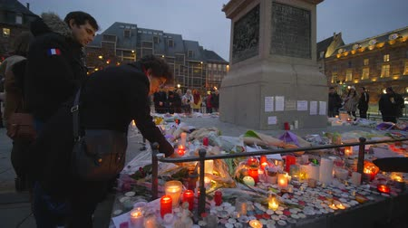 elesett : STRASBOURG, FRANCE - DECEMBER 18, 2018: terrorist attack, grieving people have brought Flowers and candles in memory of victims Terrorism and military actions on eve New Year holidays at European city street