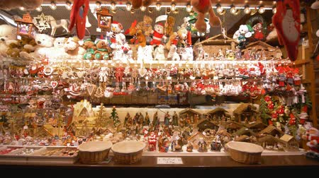urlop : STRASBOURG, FRANCE - DECEMBER 18, 2018: Christmas souvenir shop, lot of New Years presents and toys for tourists on bright store counter close-up