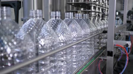 mechanization : Water factory, bottling pure spring water into plastic bottles at plant close-up Stock Footage