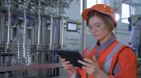 revisione : factory profession, Female Engineer in Hard Hat Uses Tablet Computer and makes photos for scanning equipment in Big plant production