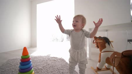 peluş : sweet smiling toddler boy plays in game room with toys at home in bright natural light