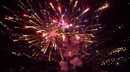 parlayan : colored firework background, beautiful salute at night heaven in slow motion